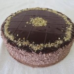 SIZE 25 CM CHOCOLATE NUT MOUSSE Rich chocolate mousse with roasted nuts layered with chocolate cake and ganache topping.