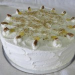 SIZE 30 CM  CARROT CAKE (LIGHT AIRY) A light airy spicey sponge with pineapples and roasted nuts iced with cream cheese icing.