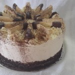 SIZE 28 CM TIRAMISU CAKE Chocolate cake soaked with Amarula liqueur, layered with a mascarpone and cream filling and dusted with cocoa.