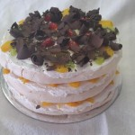 SIZE 30 CM FRUIT PAVLOVA Three layers of meringue put together with a fresh cream and seasonal fruit. (Can also be done as a black forest pavlova with chocolate and cherries)