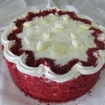 SIZE 25 CM BAKED CHEESE RED VELVET A baked cheese cake topped with a red velvet sponge and cream cheese icing.
