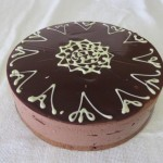 SIZE 25 CM FRIDGE CHEESE CHOCOLATE Fridge cheese cake flavoured with dark chocolate and ganache topping.