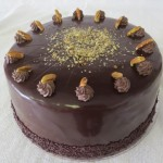 SIZE 28 CM CHOCOLATE PECAN CAKE  Layers of chocolate cake with a chocolate cream filling and roasted pecan nuts finished with